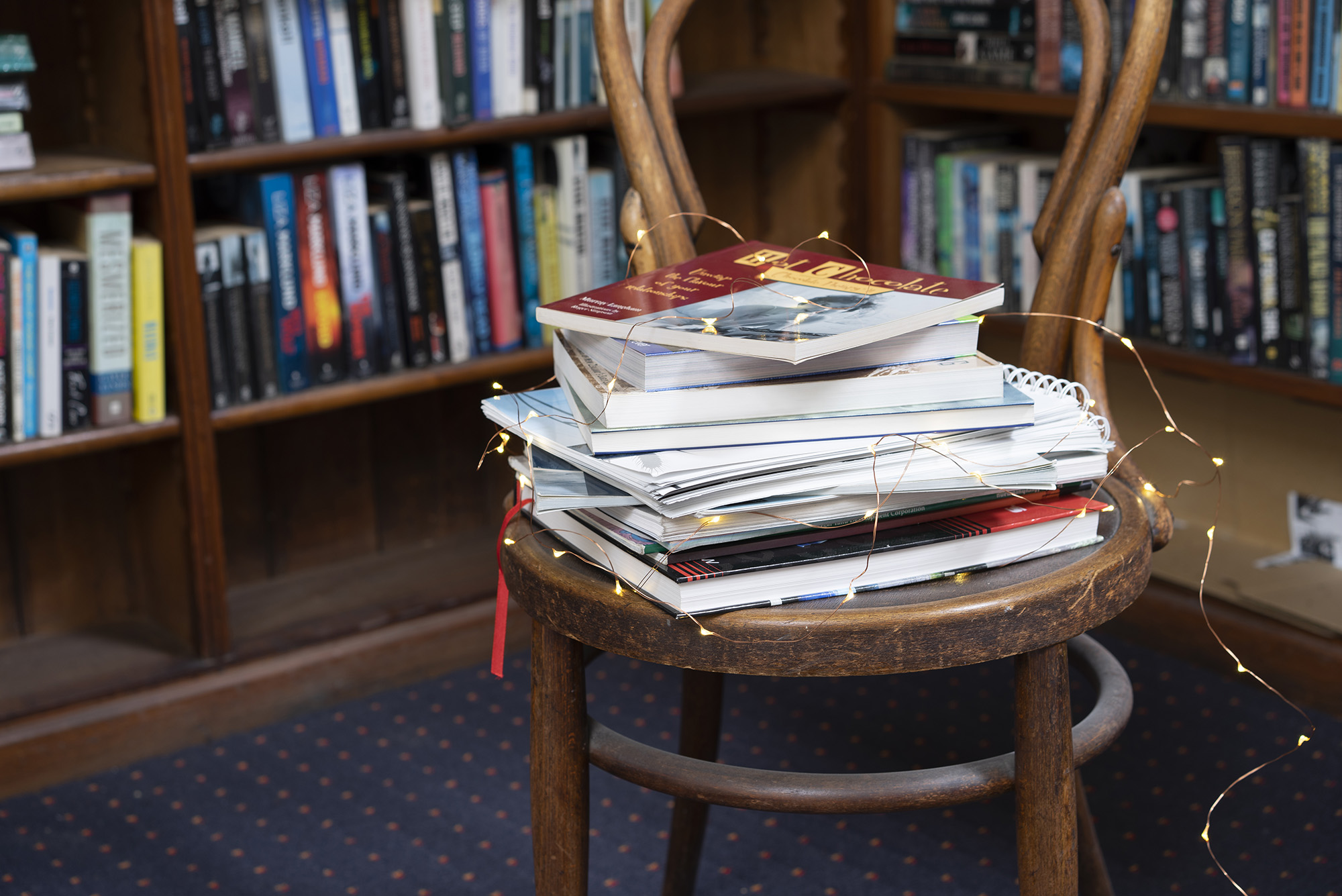 Pile of books on a chair